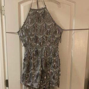 Never worn new with tags open back sparkly romper